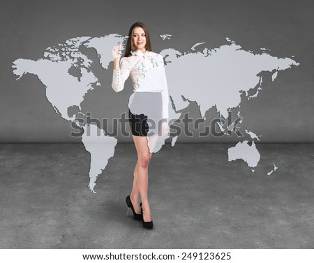 Business woman draw a point on a virtual map, a global business - stock photo