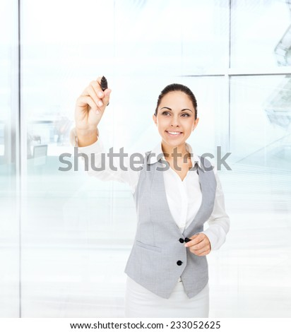 business woman draw concept on copy space, businesswoman point pen at camera, in modern office - stock photo