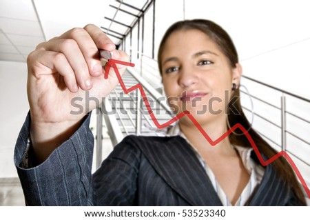 Business woman drawing a graph in an office - stock photo