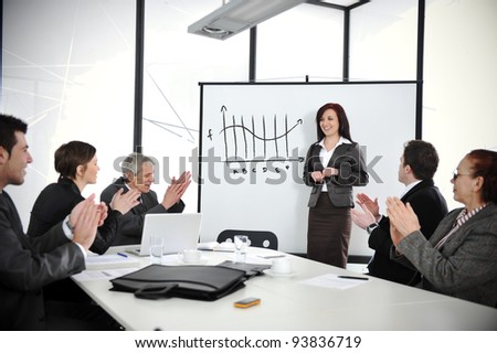Business woman drawing a graph on whiteboard during the presentation at office - stock photo