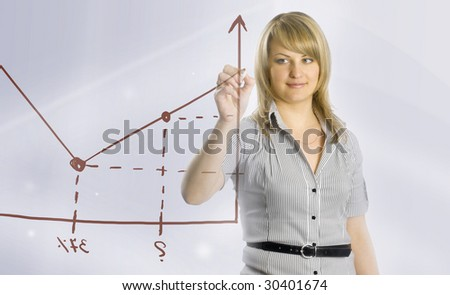 Business woman drawing graphic - stock photo