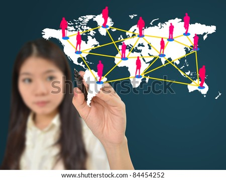 Business woman drawing social network on world map