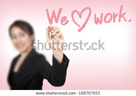 Business woman drawing we love work ( lipstick concept ) - stock photo
