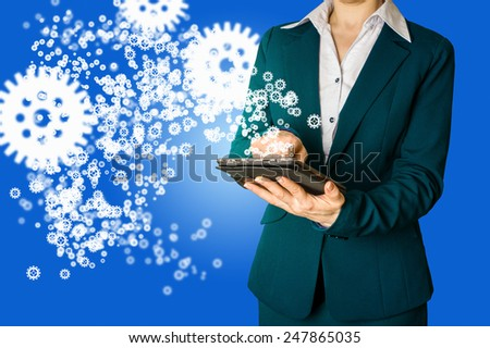 business woman draws a tablet gear to success concept - stock photo
