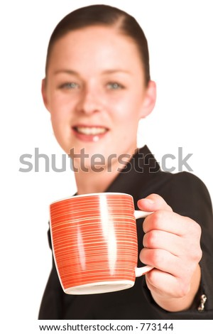 Business woman dressed in a black shirt , holding an orange coffee mug.  Shallow DOF - mug in focus, face out of focus - stock photo