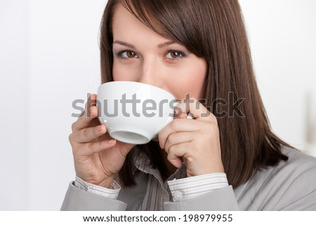 Business woman drinking tea from white cup, isolated on white - stock photo