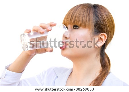 business woman drinking water - stock photo