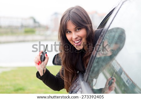 Business woman driving her new sports car - stock photo