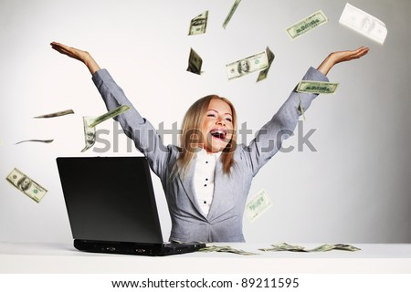 business woman drop dollars in the air - stock photo