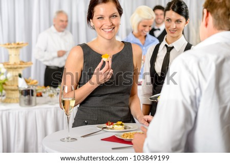 Business woman eat dessert from catering service during company meeting - stock photo