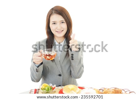 Business woman eating meals