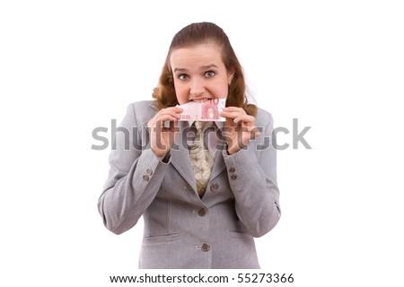 Business woman eating some money.  Businesswoman isl holding 10  euro - stock photo