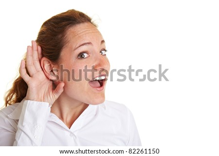 Business woman eavesdropping with hand behind her ear - stock photo