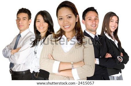 business woman facing the camera in a brown blouse with her team behind over white