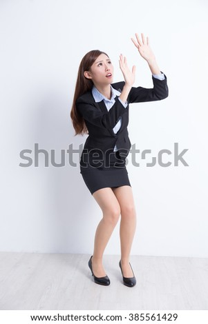 business woman fear something with white wall background, great for your design or text, asian - stock photo