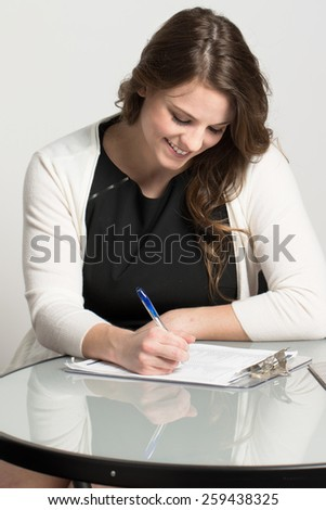 Business woman filling out a job application.  - stock photo