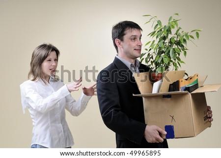 business woman firing man - stock photo