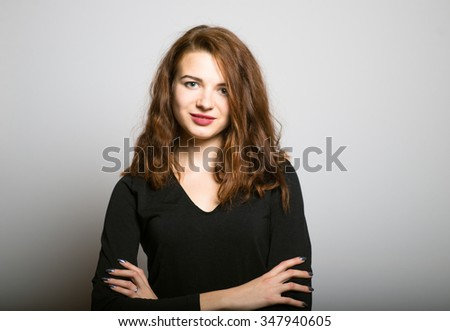 Business woman folded her arms crosswise, the office manager concept shot isolated on gray background - stock photo