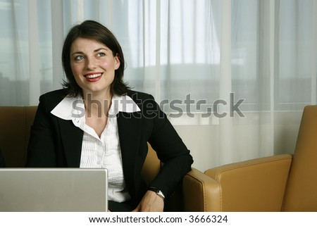 Business woman full of confidence using a laptop