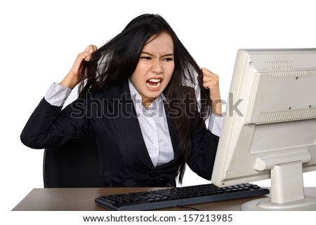 Business woman getting crazy in front of her laptop isolated over white background