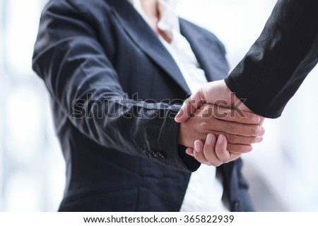 Business woman giving a handshake. - stock photo