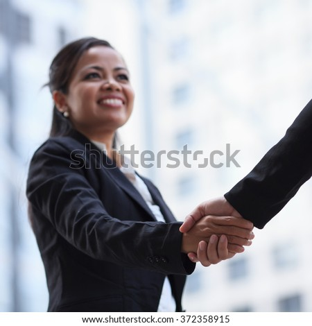 Business woman giving a handshake. - stock photo