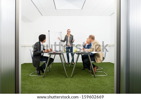 Business woman giving a presentation - stock photo