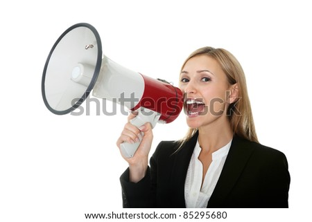Business woman giving instructions with  megaphone - stock photo
