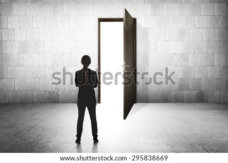 Business woman going to the open door. Career path conceptual