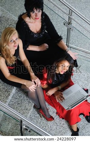 business woman group team work on laptop at staircase