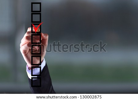 business woman hand choose check mark on box - stock photo