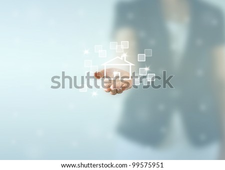 Business woman hand holding house - stock photo