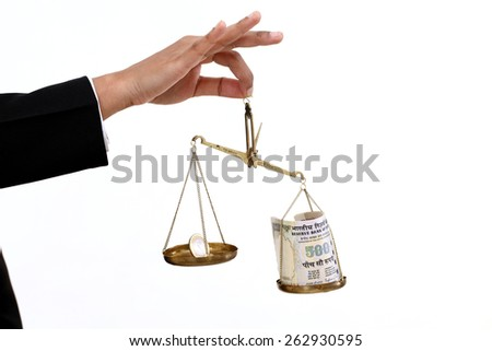 Business woman hand holding the justice scale - stock photo