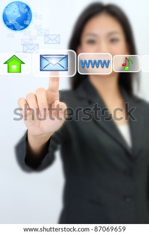 Business woman hand pressing email icon - stock photo