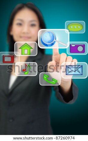 Business woman hand pressing internet icon - stock photo