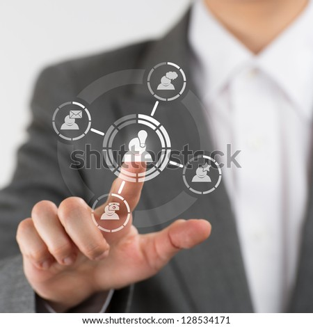 Business woman hand pressing social media icon - stock photo