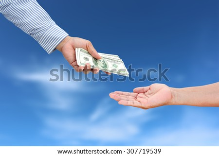 business woman hand sent dollar money to other hand.
