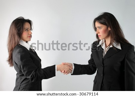 business woman hand shaking herself