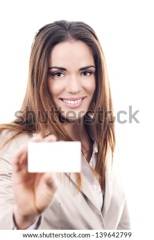 business woman handing a blank business card in studio - stock photo