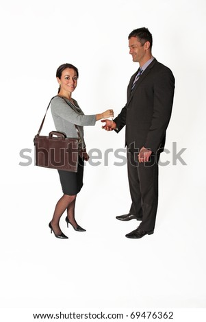 Business woman hands keys to business man