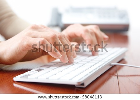 Business woman hands typing on the white keyboard - stock photo
