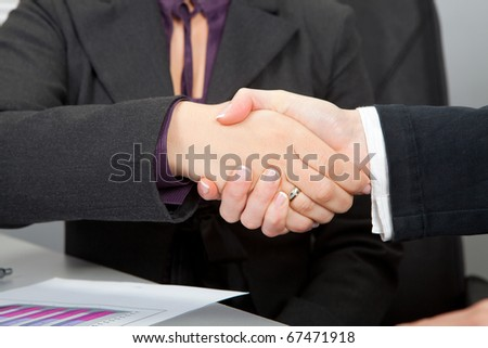 Business woman handshake in office