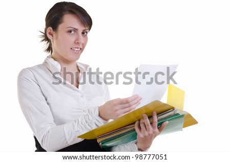 business woman happily holding a pile of files in hands, Eye contact, high key - stock photo