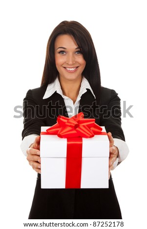 Business woman happy smile hold gift box in hands. Isolated over white background.