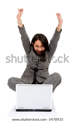 business woman happy with her success while working on a laptop - isolated over a white background - stock photo