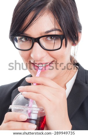 Business woman having a healthy juice with straw and break after work - stock photo