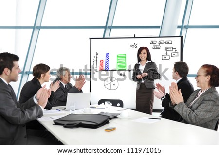 Business woman having successful presentation - stock photo