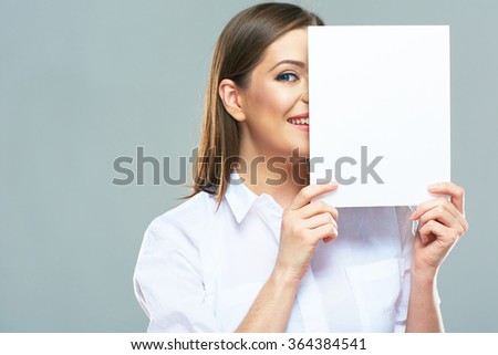 Business woman hide face behind white sign board. Positive emotional female model. Isolated portrait. - stock photo
