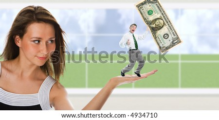 business woman hold man with dollar on palm over window - stock photo