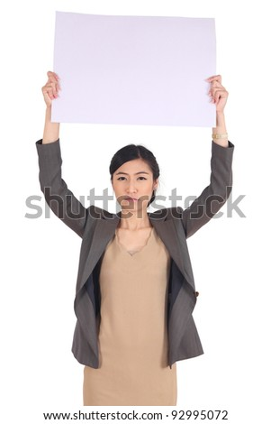 business woman  holding a big blank card - stock photo